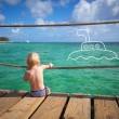 The child dreams on a sea beach — Stock Photo #40093699