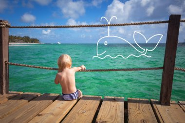 The child dreams on a sea beach