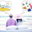 Couple sitting on the beach and thinking about different things — ストック写真