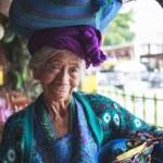 Постер, плакат: PANAJACHEL GUATEMALA APRIL 05: Old woman in ethnic traditiona