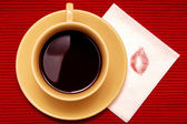 Lipstick kiss with cup of coffee — Stock Photo