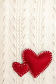 Valentines on knitted texture — Stock Photo