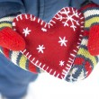 Christmas heart in mittens — Stock Photo