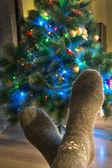 Wool socks and Christmas tree — Stock Photo