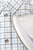 Electric iron and checkered shirt — 图库照片