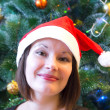 Woman in Christmas hat — Stock Photo