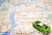 Toy car on map — Stock Photo