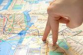 Fingers walking on map — Stock Photo