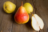 Pears on wooden table — Stock Photo