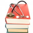 Stethoscope and stack of books — Stock Photo #24785979