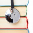 Stethoscope and stack of books — Stock Photo #24785991