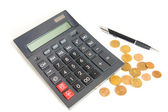 Сalculator, pen and coins — Stock Photo