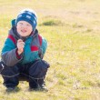 Child (boy) on dry grass (field) — Stock Photo