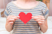 Red heart in female hands — Stock Photo
