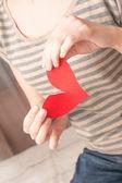 Break red heart in hand — Stock Photo