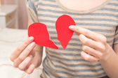 Broken heart in hands — Stock Photo