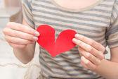 Break red heart in hands — Stock Photo