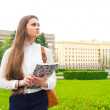 Woman with textbook outdoor — Stock Photo