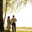 Happy couple under tree — Stock Photo