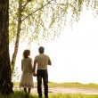 Stockfoto: Happy couple under tree