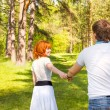 Happy couple in summer park — Stock Photo