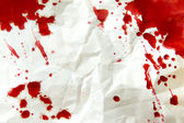 Crumpled paper with blood splatter — Stock Photo