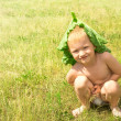 Child on green grass — Stock fotografie