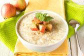 Oatmeal porridge with apple — Stock Photo