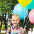 Little boy with balloons — Stok fotoğraf