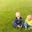 Happy children on green grass — Stock Photo