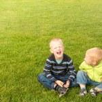 Happy children on green grass — Stock Photo