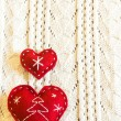 Red christmas hearts on wool — Stock Photo