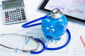 Stethoscope and piggy bank for health insurance concept — Stock Photo