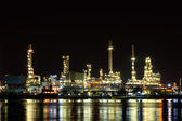 Oil Refineray at night with reflection — Stock Photo