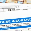 Stock Photo: House insurance application with construction plan