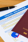 Travel insurance application form with pen and passport — Foto Stock