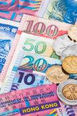 Hong Kong dollar money banknote close-up with coins — Stock Photo