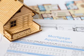 House mortgage application with model house and construction pla — Stock Photo