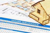 House insurance application with model house and construction pl — Stock Photo