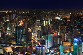 Downtown and business district in bangkok at night — Stock Photo