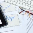 Tablet computer and financial charts for stock investment analys — Stock Photo