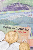 Indonesian money rupiah banknote and coins close-up — Stock Photo