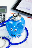 Stethoscope and piggy bank for financial health check concept — Stock Photo