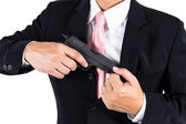 Businessman pull out gun from jacket concept for aggression — Stock Photo