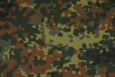 German military flecktarn camouflage fabric texture background — Stockfoto