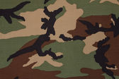 US military woodland camouflage fabric texture background — Stockfoto