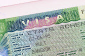 Schengen visa in passport macro — Stock Photo