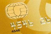 Gold credit card with micro chip selective focus — Stock Photo
