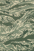Green digital tigerstripe camouflage fabric texture background — Stock Photo