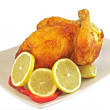 Chicken fried with lemon - Stock Photo